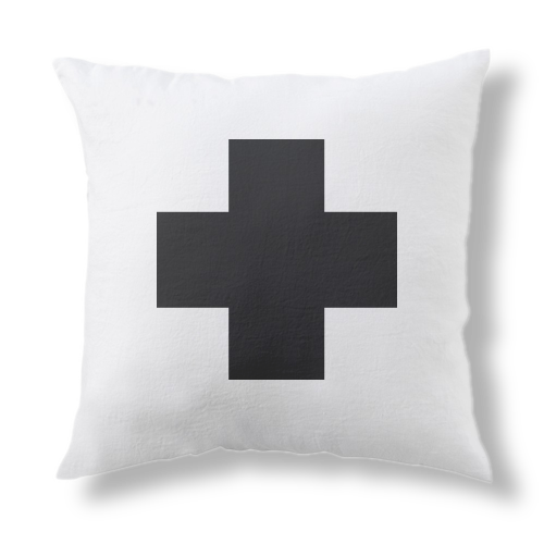 Pillow with croos sign on it